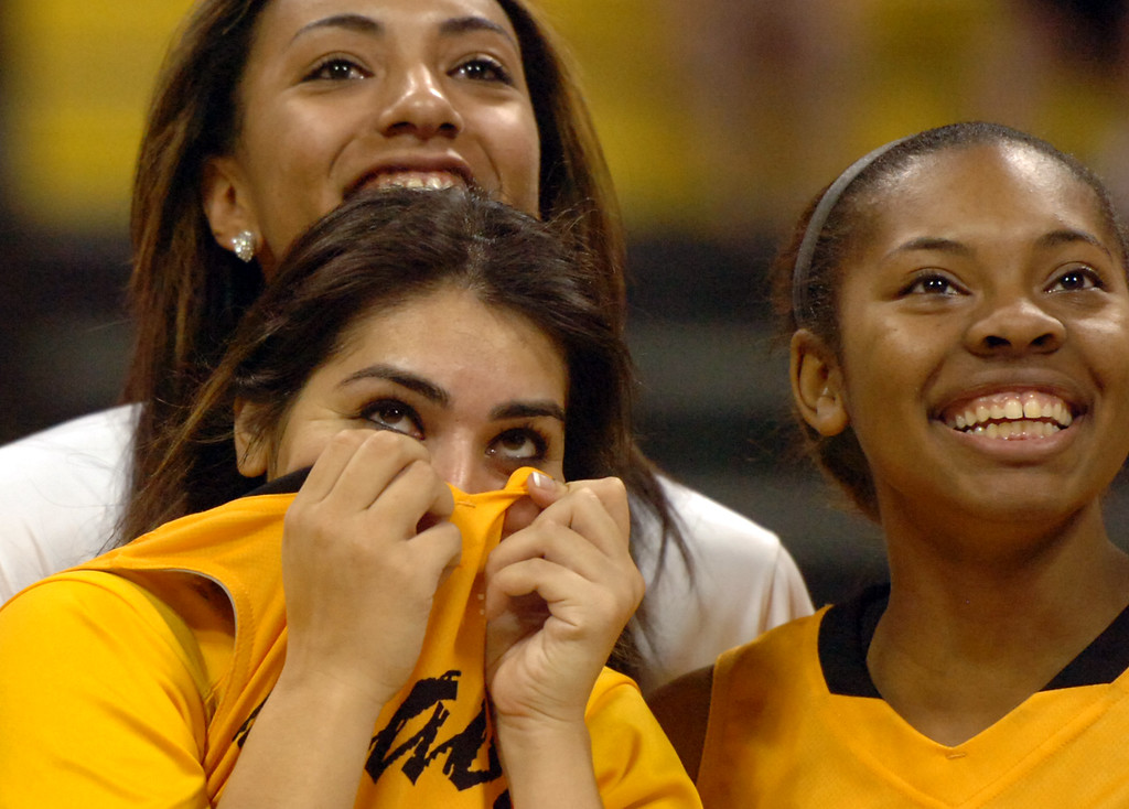 . Long Beach State\'s Alex Sanchez reacts as she looks up to the score board as she is proposed to by her boyfriend after the women\'s Basketball  game vs. Cal Poly at Walter Pyramid in Long Beach, CA Friday January 18, 2014.