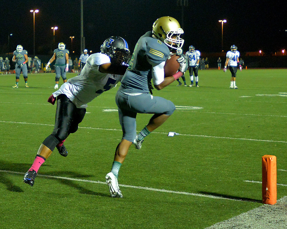 . Poly\'s Jeremy Calhoun scores a touchdown against Jordan\'s Daniel Palu in Friday night\'s Moore League football game at Veterans Stadium in Long Beach, CA. on October 11, 2013. (Photo by Sean Hiller/Press Telegram)