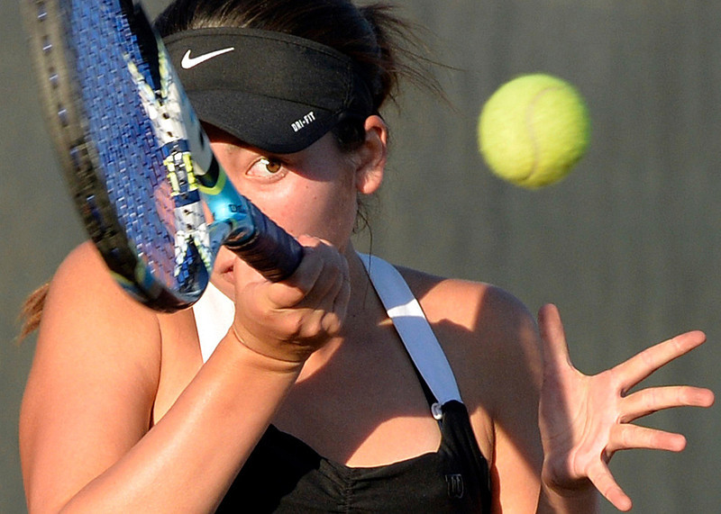 . Long Beach Poly\'s Jasmine Roberts keeps her eye on the ball as she plays against Wilson in Long Beach CA Thursday October 17, 2013. Wilson won 9-9 (77-65) to win the  Moore League Championship.