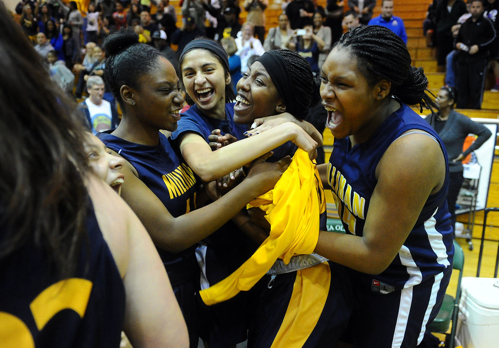 . Millikan players celebrate their victory in Brea, CA on Tuesday, March 4, 2014. CIF Girls\' Basketball, Millikan vs. Brea Olinda, Division 1AA semifinal. 2nd half. Millikan won 70-66.(Photo by Scott Varley, Daily Breeze)