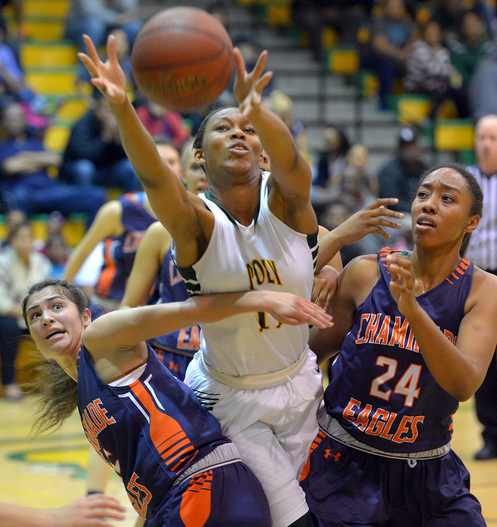 . Poly\'s Lajahna Drummer grabs an offensive rebound against Chaminade\'s Natalie Valenzuela, left, and Devin Stanback in Long Beach, CA on Wednesday, February 26, 2014. Qtr finals of the girls CIF Open Div. girls basketball playoffs, Long Beach Poly vs Chaminade. (Photo by Scott Varley, Daily Breeze)
