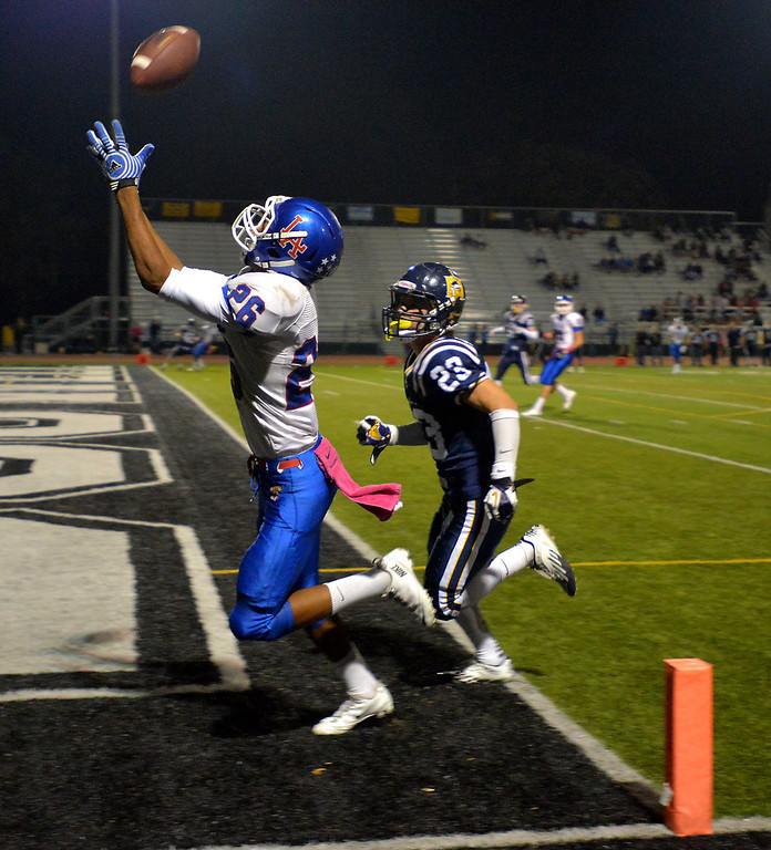 . Los Alamitos\' Cameron Austin hauls in a touchdown pass in the second quarter over Marina\'s Parker Melfi in Thursday\'s Sunset League high school football game at Westminster High School in Westminster, CA. on October 17, 2013. (Photo by Sean Hiller/Press Telegram)