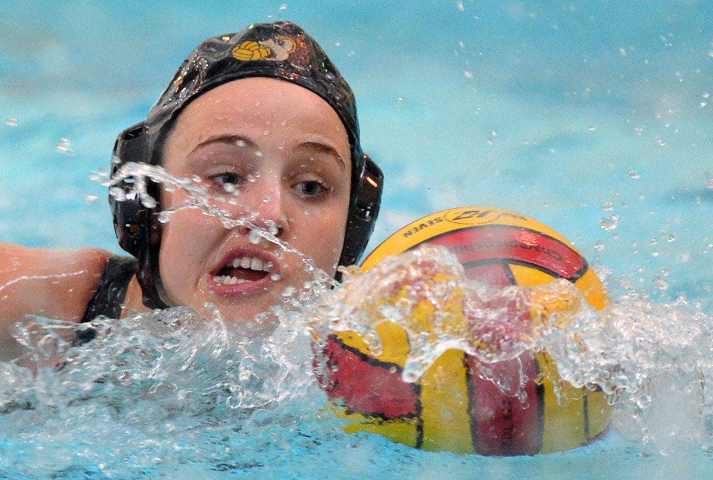 . Wilson\'s Jessie King moves into scoring position against Millikan in Long Beach, CA on Thursday, January 23, 2014. Wilson\'s girls water polo team beat Millikan 21-6 in the Moore League matchup at Wilson High. (Photo by Scott Varley, Daily Breeze)