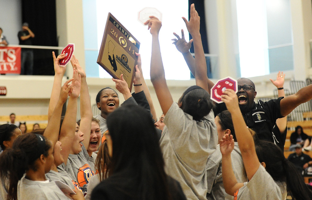 . Bishop Montgomery celebrates beating JSerra 46-43 in the CIF Southern Section Division 4-AA girls basketball final at Azusa Pacific University in Azusa, CA. on Saturday March 8, 2014. (Photo by Sean Hiller/ Daily Breeze).