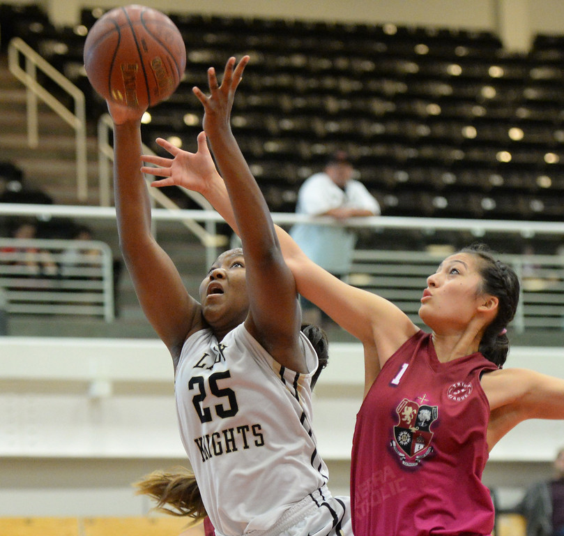 . Bishop Montgomery\'s Janelle Odionu, left, grabs a rebound over JSerra\'s Caroline Coco Miller in the CIF Southern Section Division 4-AA girls basketball final at Azusa Pacific University in Azusa, CA. on Saturday March 8, 2014. (Photo by Sean Hiller/ Daily Breeze).