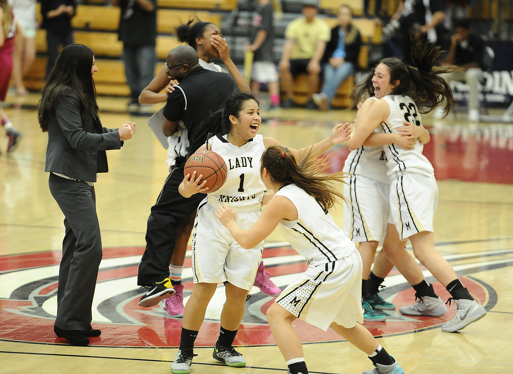 . Bishop Montgomery\'s Jessica Malazarte (1) kicks off the celebration after beating JSerra 46-43 in the CIF Southern Section Division 4-AA girls basketball final at Azusa Pacific University in Azusa, CA. on Saturday March 8, 2014. (Photo by Sean Hiller/ Daily Breeze).
