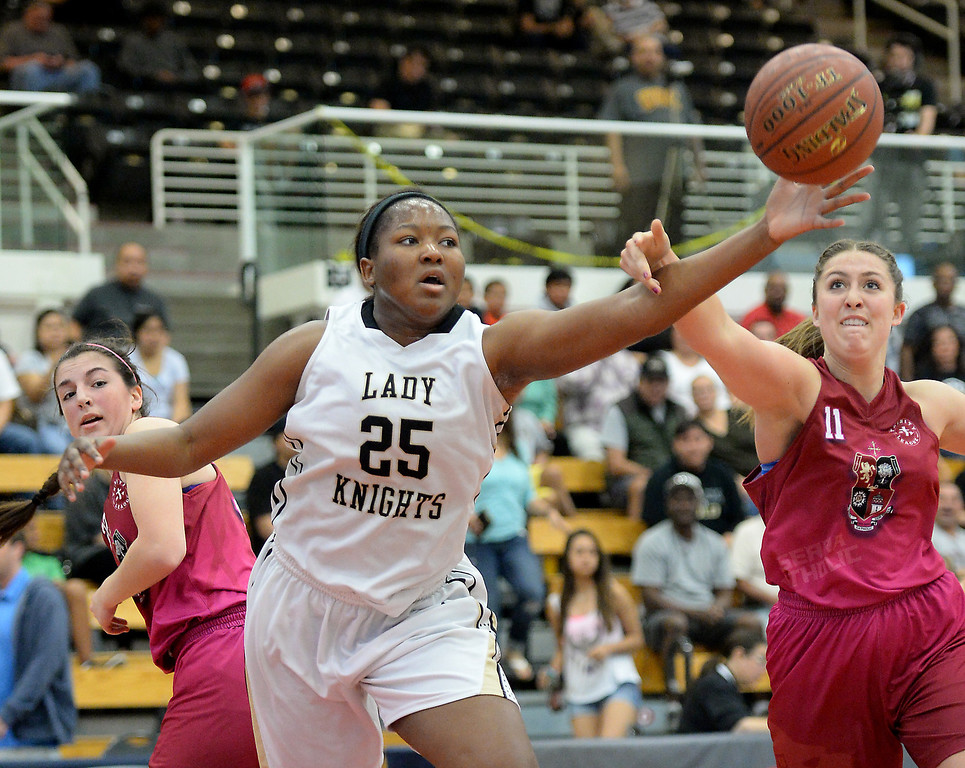 . Bishop Montgomery\'s Janelle Odionu (25), left, battles JSerra\'s Kaitlyn Reis (11) in the CIF Southern Section Division 4-AA girls basketball final at Azusa Pacific University in Azusa, CA. on Saturday March 8, 2014. (Photo by Sean Hiller/ Daily Breeze).