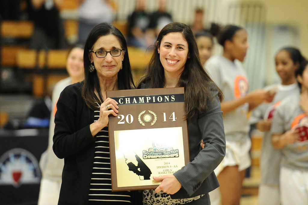 . Bishop Montgomery\'s Coach Bridgette Reyes celebrates the win over JSerra in the CIF Southern Section Division 4-AA girls basketball final at Azusa Pacific University in Azusa, CA. on Saturday March 8, 2014. (Photo by Sean Hiller/ Daily Breeze).