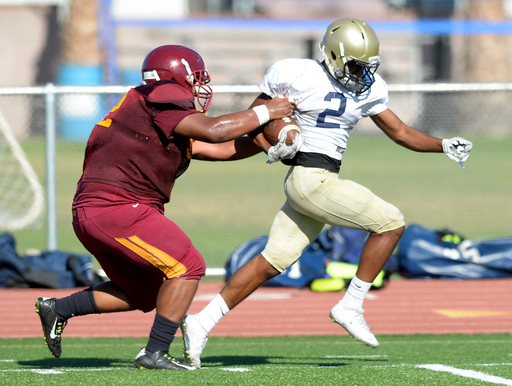 . St. John Bosco vs. Long Beach Wilson  Bosco\'s (2) gets past Wilson\'s Williams De La Cruz (52) for a long run touchdown during a football scrimmage at St.John Bosco Friday, August 19, 2016, Bellflower, CA.   Photo by Steve McCrank/Staff Photographer