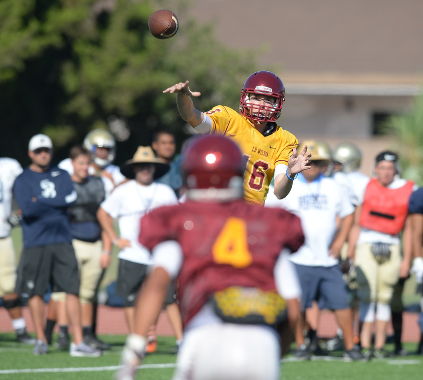 . St. John Bosco vs. Long Beach Wilson  Wilson\'s quarterback Tanner Frost passes to Francisco Narez (4) during a football scrimmage at St.John Bosco Friday, August 19, 2016, Bellflower, CA.   Photo by Steve McCrank/Staff Photographer