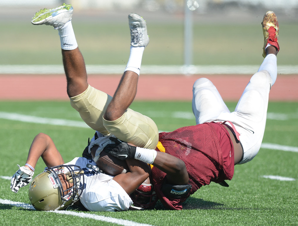 . St. John Bosco vs. Long Beach Wilson  Bosco\'s (2) is stopped just short of the goal line by Wilson\'s (5) and (23) during a football scrimmage at St.John Bosco Friday, August 19, 2016, Bellflower, CA.   Photo by Steve McCrank/Staff Photographer