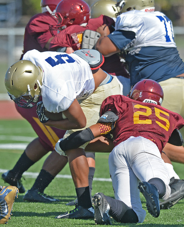 . St. John Bosco vs. Long Beach Wilson  Bosco\'s (5) blasts through Wilson defenders to find the endzone during a football scrimmage at St.John Bosco Friday, August 19, 2016, Bellflower, CA.   Photo by Steve McCrank/Staff Photographer