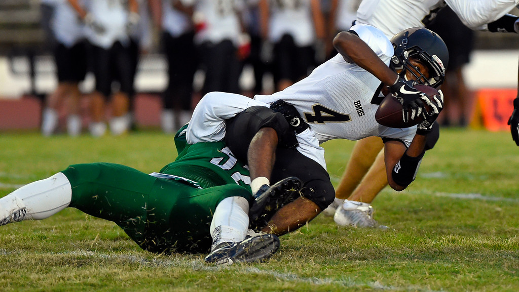 . Bishop�s Ahmad Bealey gets tackled for a loss by Inglewood�s Jalen Rudd in Inglewood, CA on Thursday, September 14, 2017. Bishop Montgomery vs Inglewood preseason football. (Photo by Scott Varley, Daily Breeze/SCNG)