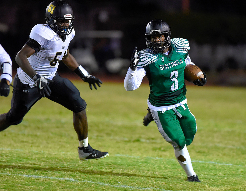. Inglewood�s Teshawn White is pursued out of the backfield in Inglewood, CA on Thursday, September 14, 2017. Bishop Montgomery vs Inglewood preseason football. (Photo by Scott Varley, Daily Breeze/SCNG)