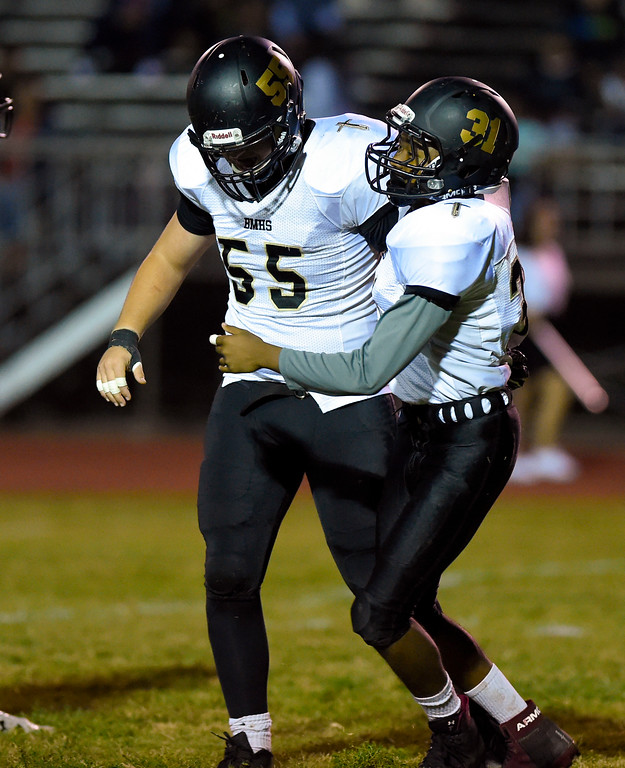 . Bishop�s Jackson Arthur, left, and Alexandre Some celebrate a 2-point safety in Inglewood, CA on Thursday, September 14, 2017. Bishop Montgomery vs Inglewood preseason football. (Photo by Scott Varley, Daily Breeze/SCNG)