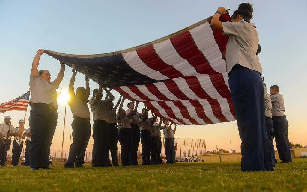 . Members of Inglewood High\'s ROTC program hold the American flag during the National Anthem before a preseason football game in Inglewood, CA on Thursday, September 14, 2017. (Photo by Scott Varley, Daily Breeze/SCNG)