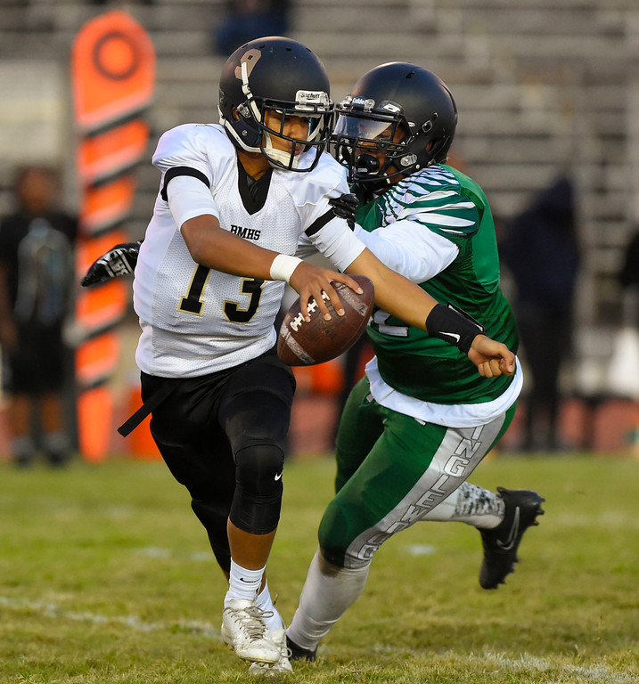 . Bishop QB Matthew Cortez is sacked for a loss by Inglewood��ôs Jalen Rudd in Inglewood, CA on Thursday, September 14, 2017. Bishop Montgomery vs Inglewood preseason football. (Photo by Scott Varley, Daily Breeze/SCNG)