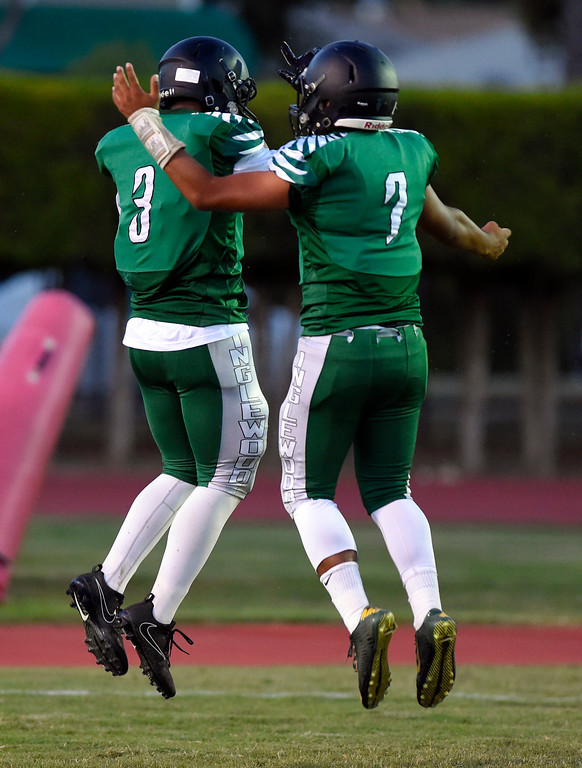 . After a TD, Inglewood�s Teshawn White, left, celebrates with his QB Carlos Fernandez in Inglewood, CA on Thursday, September 14, 2017. Bishop Montgomery vs Inglewood preseason football. (Photo by Scott Varley, Daily Breeze/SCNG)