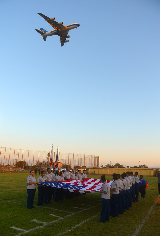 . A China Southern Airlines Airbus A380 on final approach to LAX flies over Coleman Stadium as the Inglewood High ROTC members hold the flag before the National Anthem in Inglewood, CA on Thursday, September 14, 2017. Inglewood High was playing a preseason football game against Bishop Montgomery. (Photo by Scott Varley, Daily Breeze/SCNG)