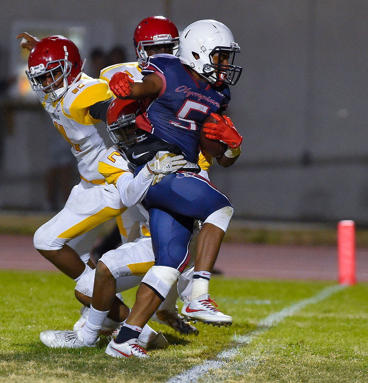. Leuzinger\'s Elijah Myles drags several Hawthorne defenders across the goal line for a touchdown in Lawndale, CA on Friday, September 22, 2017. (Photo by Scott Varley, Daily Breeze/SCNG)