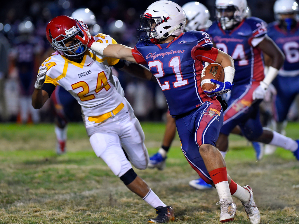 . Despite the stiff arm by Leuzinger\'s Jammal Ali, Hawthorne\'s Nick Robledo was able to make the tackle in Lawndale, CA on Friday, September 22, 2017. (Photo by Scott Varley, Daily Breeze/SCNG)
