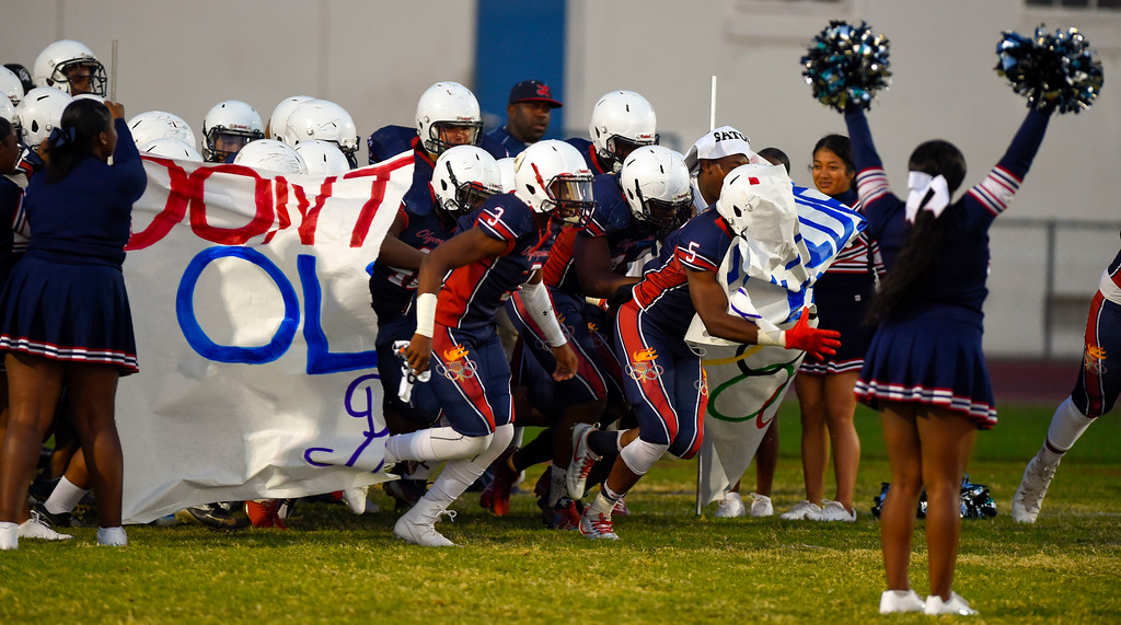 . The Leuzinger Olympians tear through their banner as they take the field before their big win over Hawthorne High in Lawndale, CA on Friday, September 22, 2017. (Photo by Scott Varley, Daily Breeze/SCNG)