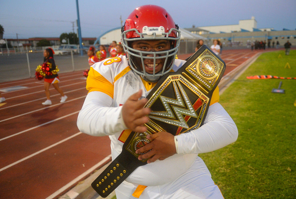 . Hawthorne High�s Jayven Tuua comes fired up and prepared with a wrestling belt before his football game against Leuzinger in Lawndale, CA on Friday, September 22, 2017. (Photo by Scott Varley, Daily Breeze/SCNG)
