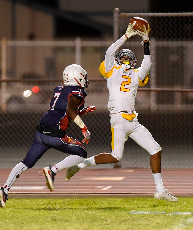 . Hawthorne\'s Devante Wartell hauls in a pass at the end zone for a touchdown as Leuzinger\'s Semaj Daniels defends in Lawndale, CA on Friday, September 22, 2017. (Photo by Scott Varley, Daily Breeze/SCNG)