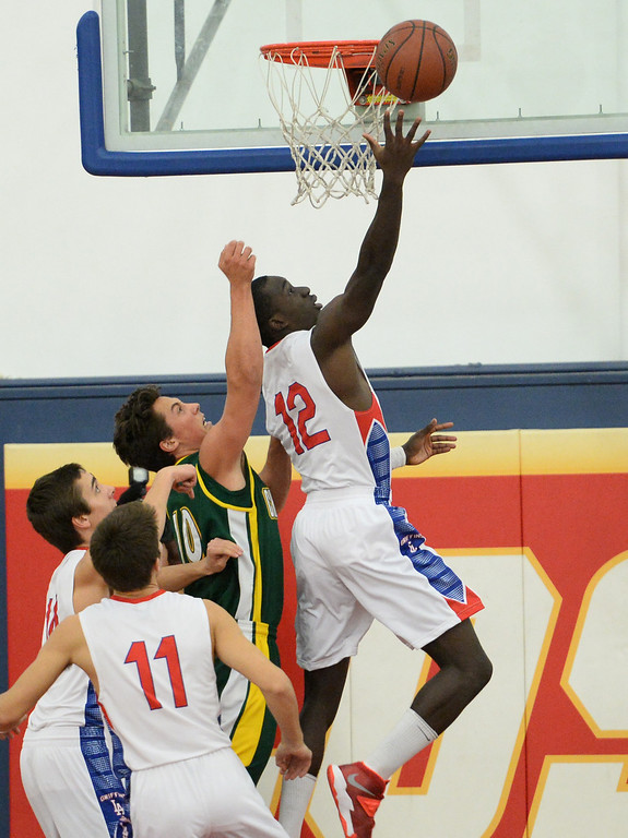 . Los Alamitos\'s Bryan Igboke i grabs a rebound over Edison in the Sunset League boy\'s basketball game in Los Alamitos, CA. on Friday, January 17, 2014. (Photo by Sean Hiller/ Daily Breeze).