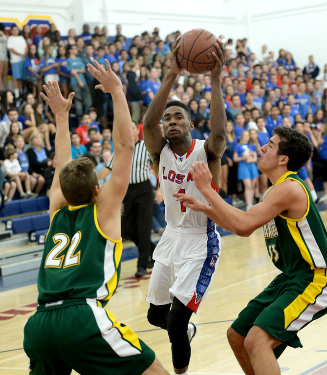 . Los Alamitos\' Khalid Washington is blocked by Edison\'s Garrett White,left, andDerek Molina in the Sunset League boy\'s basketball game in Los Alamitos, CA. on Friday, January 17, 2014. (Photo by Sean Hiller/ Daily Breeze).