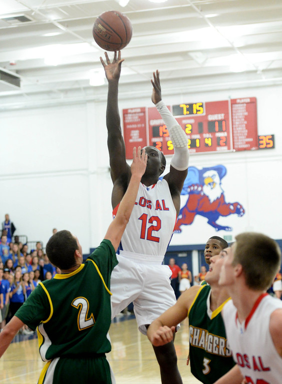 . Los Alamitos\'s Bryan Igboke is blocked by Edison\'s Brae Ivey in the Sunset League boy\'s basketball game in Los Alamitos, CA. on Friday, January 17, 2014. (Photo by Sean Hiller/ Daily Breeze).