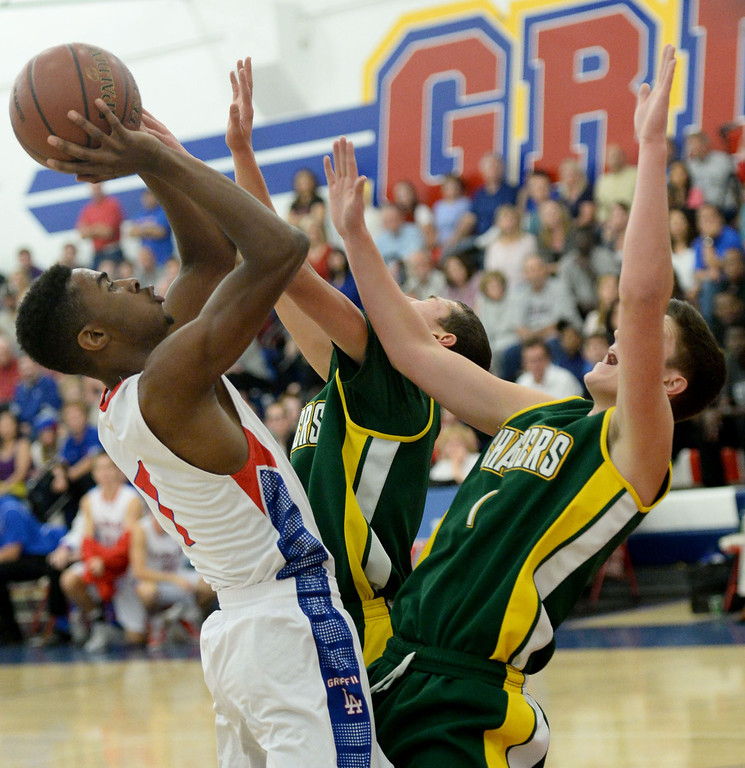 . Los Alamitos\' Khalid Washington battles Edison in the Sunset League boy\'s basketball game in Los Alamitos, CA. on Friday, January 17, 2014. (Photo by Sean Hiller/ Daily Breeze).