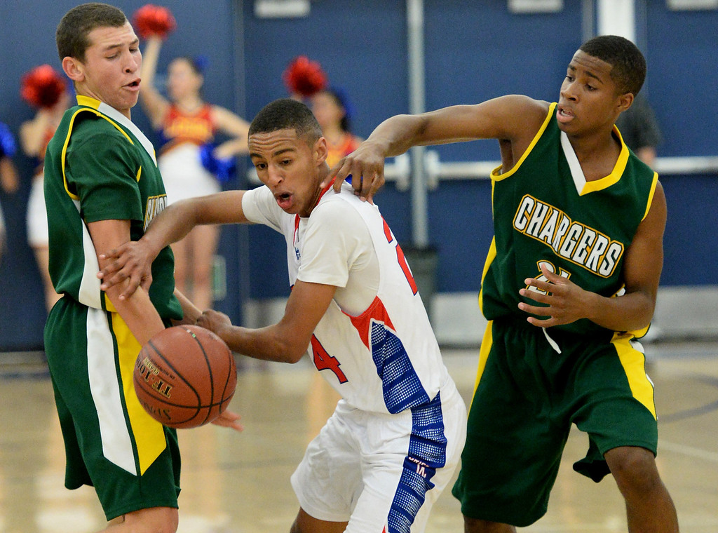. Los Alamitos\' Eyassu Worku battles Edison\'s Brae Ivey, left, and Randall Walker in the Sunset League boy\'s basketball game in Los Alamitos, CA. on Friday, January 17, 2014. (Photo by Sean Hiller/ Daily Breeze).