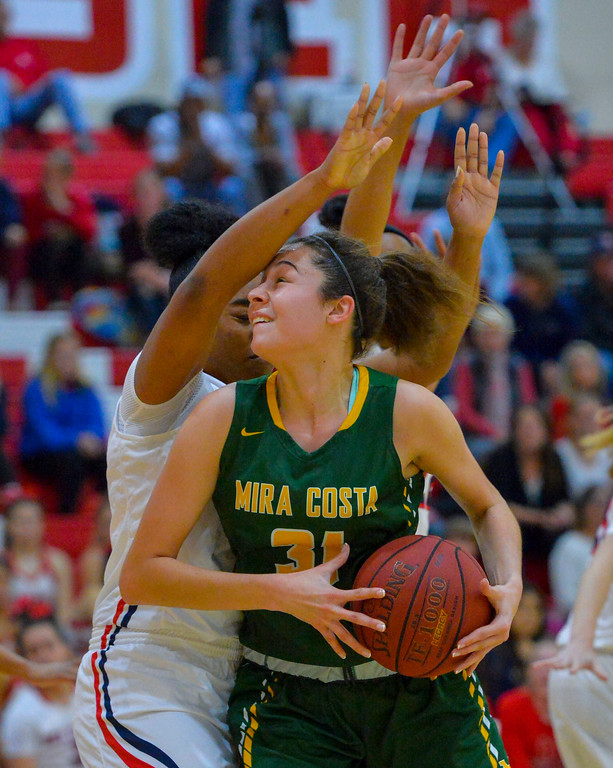 . Costa�s Allie Navarette is fouled by Redondo�s Isaan Taylor in Redondo Beach, CA on Thursday, February 9, 2017. Mira Costa girls basketball team came from behind to beat Redondo 44-41. (Photo by Scott Varley, Daily Breeze/SCNG)