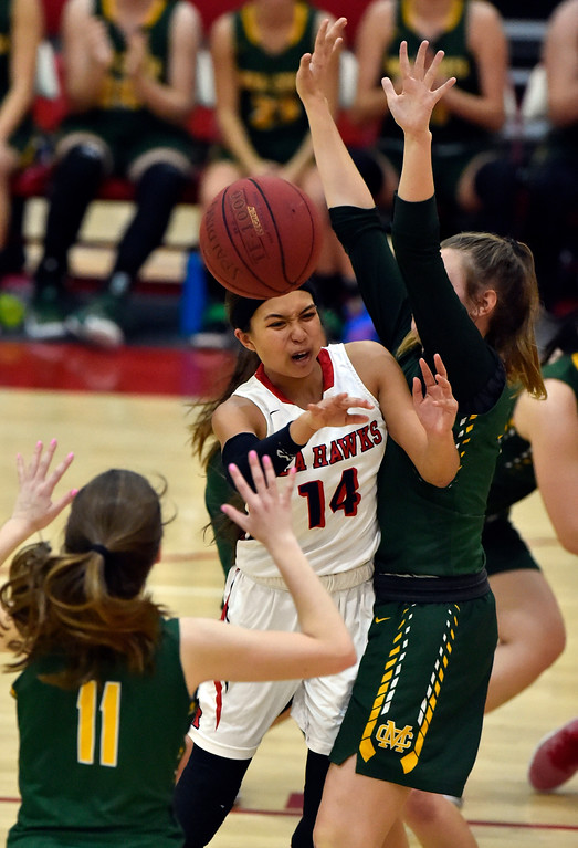 . Under pressure, Redondo�s Alyssa Munn passes the ball off under the basket in Redondo Beach, CA on Thursday, February 9, 2017. Mira Costa girls basketball team came from behind to beat Redondo 44-41. (Photo by Scott Varley, Daily Breeze/SCNG)