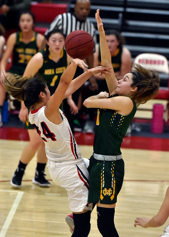 . Costa�s Allie Navarette, right, blocks and strips the ball from Redondo�s Lane Arkangel in Redondo Beach, CA on Thursday, February 9, 2017. Mira Costa girls basketball team came from behind to beat Redondo 44-41. (Photo by Scott Varley, Daily Breeze/SCNG)