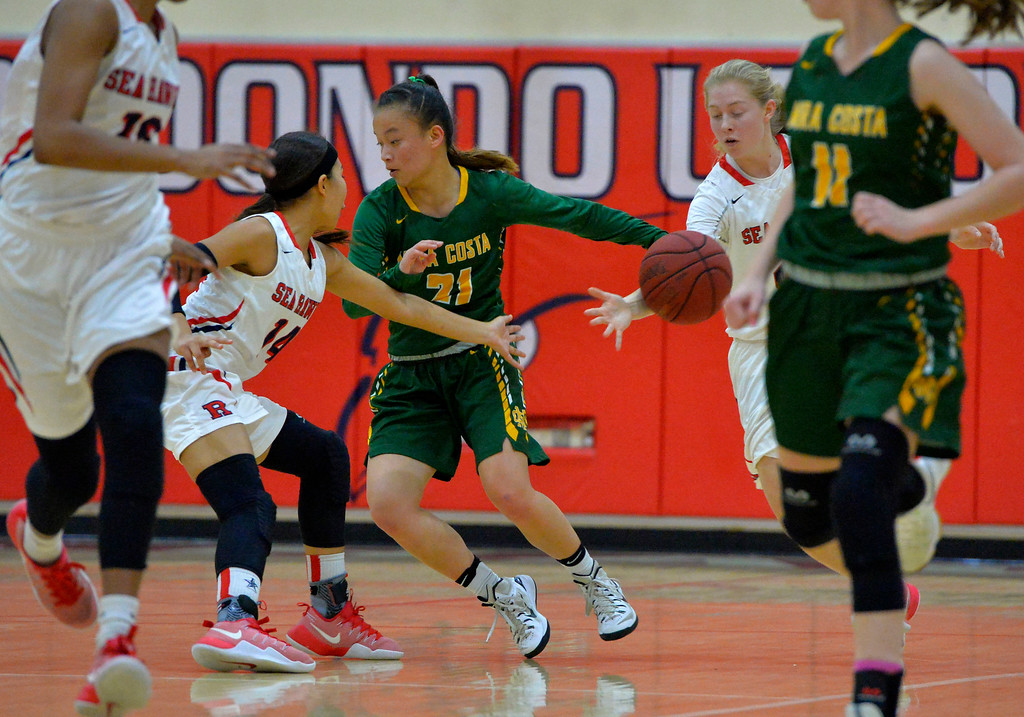 . Costa ball carrier Kelli Toyooka has the ball stripped in Redondo Beach, CA on Thursday, February 9, 2017. Mira Costa girls basketball team came from behind to beat Redondo 44-41. (Photo by Scott Varley, Daily Breeze/SCNG)