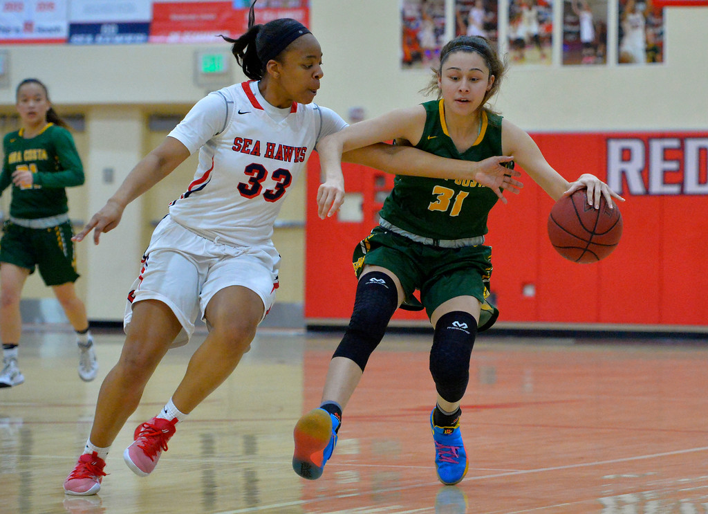 . Mira Costa�s Allie Navarette keeps the ball from Redondo defender Nicole Swift in Redondo Beach, CA on Thursday, February 9, 2017. Mira Costa girls basketball team came from behind to beat Redondo 44-41. (Photo by Scott Varley, Daily Breeze/SCNG)