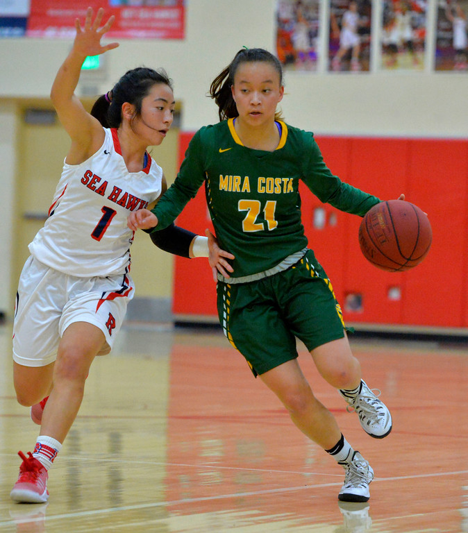 . Mira Costa�s Kelli Toyooka is defended by Redondo�s Lauren Tsuneishi in Redondo Beach, CA on Thursday, February 9, 2017. Mira Costa girls basketball team came from behind to beat Redondo 44-41. (Photo by Scott Varley, Daily Breeze/SCNG)