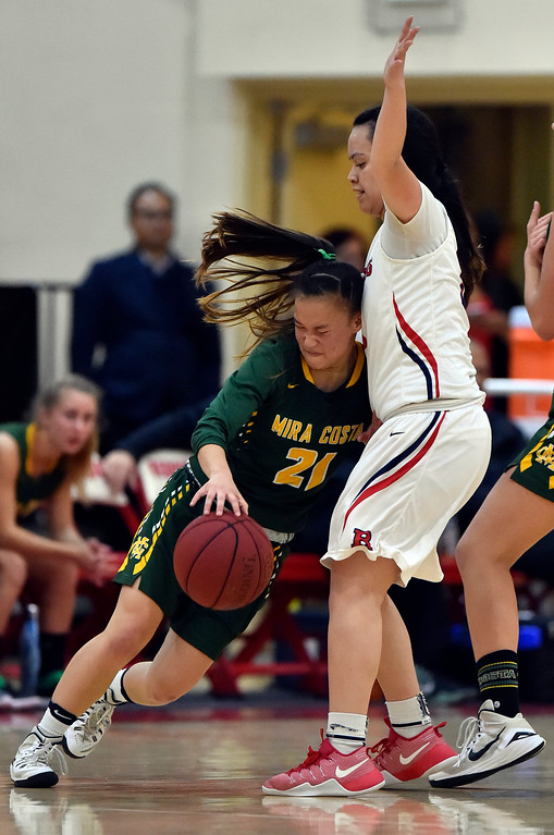 . Mira Costa�s Kelli Toyooka is unable to get through Redondo�s Makenna Peneueta in Redondo Beach, CA on Thursday, February 9, 2017. Mira Costa girls basketball team came from behind to beat Redondo 44-41. (Photo by Scott Varley, Daily Breeze/SCNG)