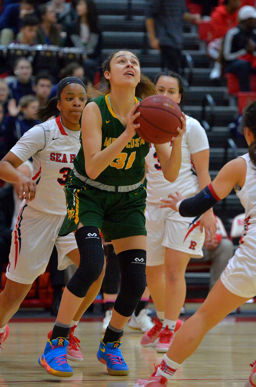 . Allie Navarette takes a shot for Mira Costa in Redondo Beach, CA on Thursday, February 9, 2017. Mira Costa girls basketball team came from behind to beat Redondo 44-41. (Photo by Scott Varley, Daily Breeze/SCNG)