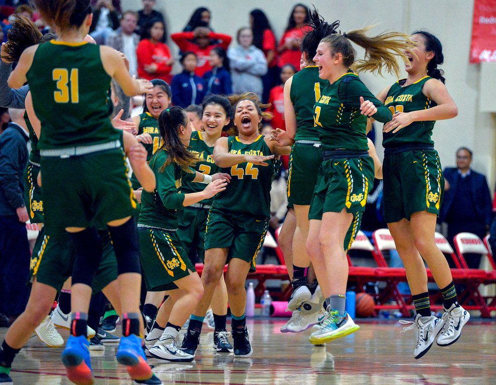 . Mira Costa players celebrate their come from behind victory and a tie for the league title in Redondo Beach, CA on Thursday, February 9, 2017. Mira Costa girls basketball team came from behind to beat Redondo 44-41. (Photo by Scott Varley, Daily Breeze/SCNG)