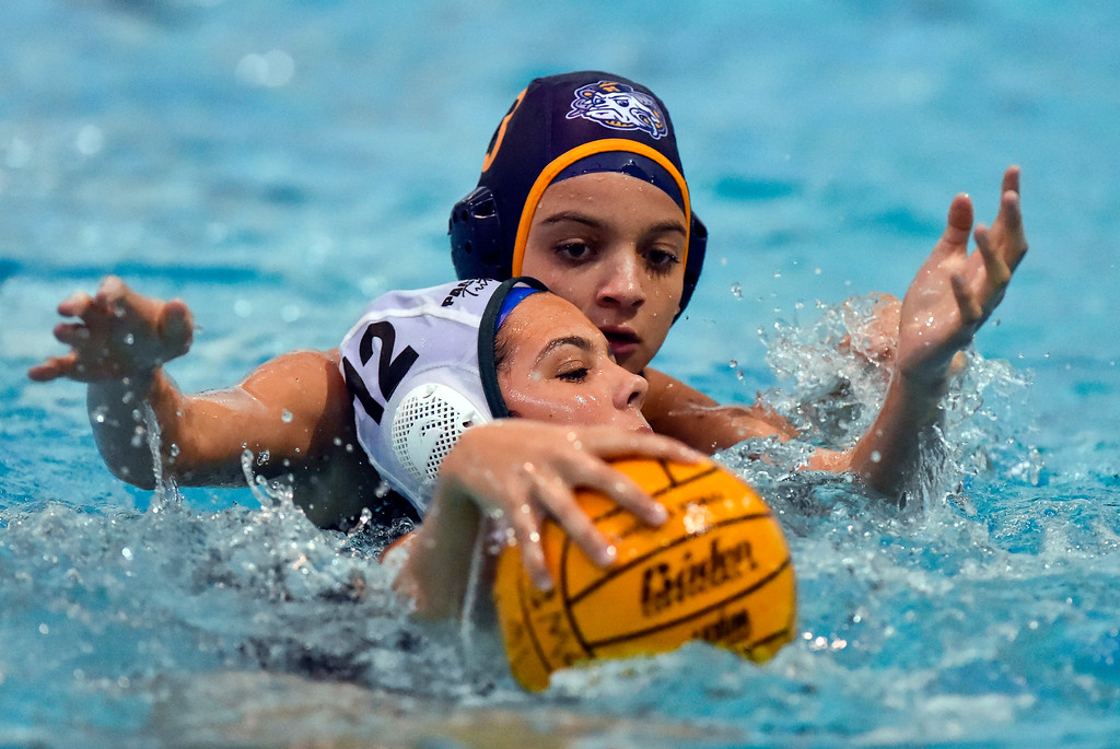 . Millikan�s Farrah Martin, rear, keeps Pacifica�s Michaela Johnson from advancing the ball up the pool in Long Beach, CA on Tuesday, February 14, 2017. Millikan beat Pacifica of Oxnard 14-7 in the opening round of the CIF Southern Section Division 5 girl\'s water polo playoffs. (Photo by Scott Varley, Press-Telegram/SCNG)