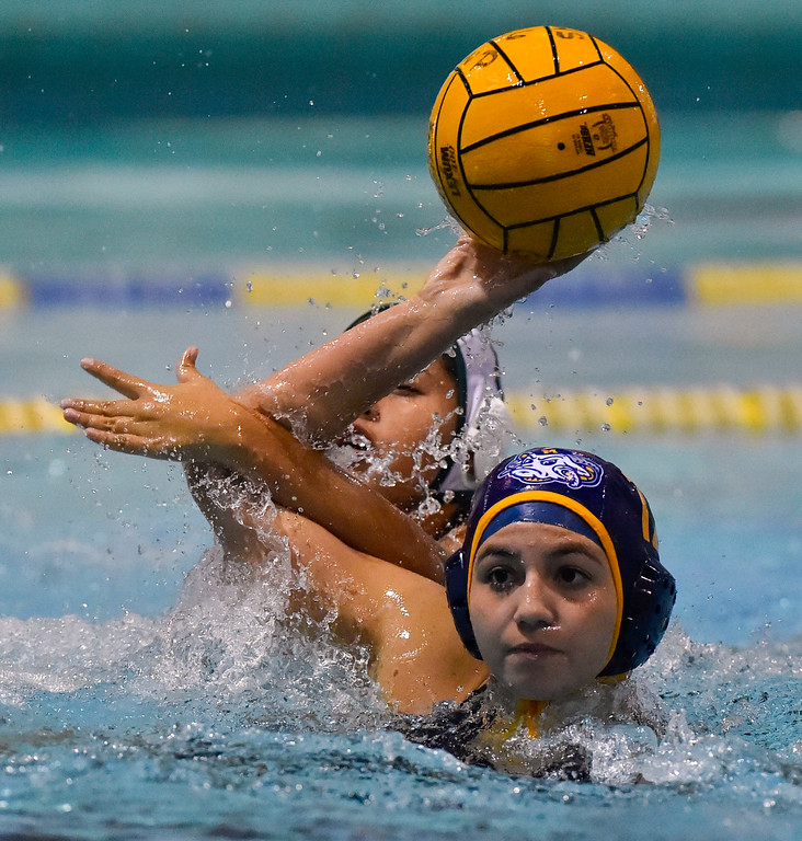 . Millikan�s Jade Vasquez has her shot hindered by Pacifica�s Juliana Guttierez in Long Beach, CA on Tuesday, February 14, 2017. Millikan beat Pacifica of Oxnard 14-7 in the opening round of the CIF Southern Section Division 5 girl\'s water polo playoffs. (Photo by Scott Varley, Press-Telegram/SCNG)