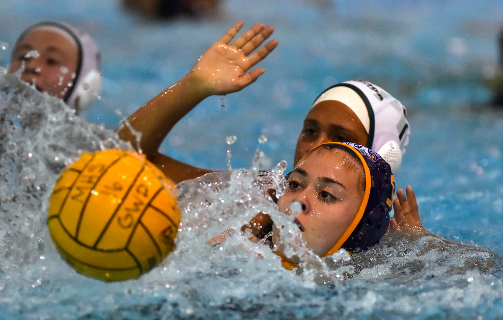 . Millikan�s Sophie Garcia is pressured by a Pacifica defender as she works her way in for a shot in Long Beach, CA on Tuesday, February 14, 2017. Millikan beat Pacifica of Oxnard 14-7 in the opening round of the CIF Southern Section Division 5 girl\'s water polo playoffs. (Photo by Scott Varley, Press-Telegram/SCNG)