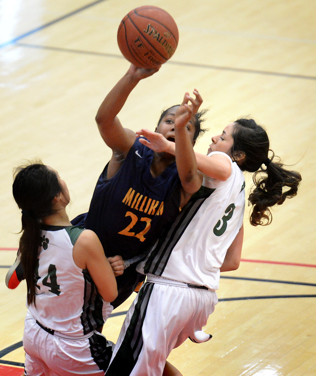 . Millikan\'s Kamila Auls (22) collides with Bonita\'s Alyssa Ono, left, and Cassie Martinez in the  56-53 win in the CIF Southern Section Division 1-AA girls basketball final at Azusa Pacific University in Azusa, CA. on Saturday March 8, 2014. (Photo by Sean Hiller/ Daily Breeze).