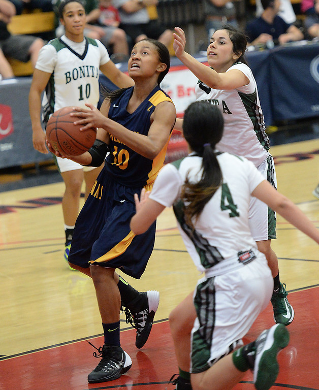 . Millikan\'s Briana Guillory drives to the basket against  Bonita in the CIF Southern Section Division 1-AA girls basketball final at Azusa Pacific University in Azusa, CA. on Saturday March 8, 2014. (Photo by Sean Hiller/ Daily Breeze).