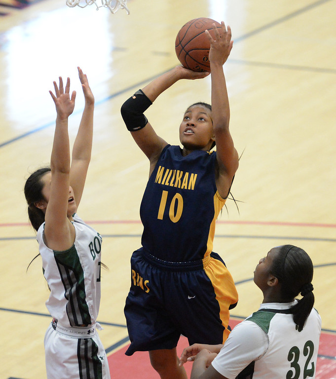 . Millikan\'s Briana Guillory drives to the basket against Bonita\'s Alyssa Ono, left, and Kandyce Smith in the CIF Southern Section Division 1-AA girls basketball final at Azusa Pacific University in Azusa, CA. on Saturday March 8, 2014. (Photo by Sean Hiller/ Daily Breeze).