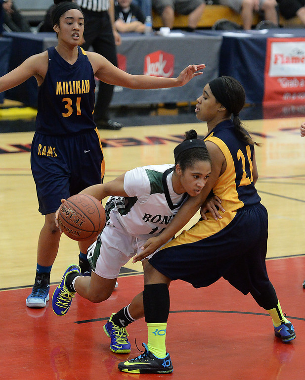 . Bonita\'s Nikki Wheatley drives between Millikan\'s Alyssa Benton, left, and Kaylin Ellis in the CIF Southern Section Division 1-AA girls basketball final at Azusa Pacific University in Azusa, CA. on Saturday March 8, 2014. (Photo by Sean Hiller/ Daily Breeze).