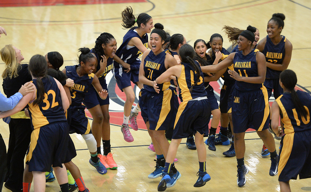 . Millikan celebrates its 56-53 win over Bonita  in the CIF Southern Section Division 1-AA girls basketball final at Azusa Pacific University in Azusa, CA. on Saturday March 8, 2014. (Photo by Sean Hiller/ Daily Breeze).